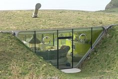 Malator, an earth-sheltered house in Wales, UK with a view of the coast; designed by architects Future Systems