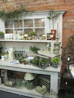 potting bench with old window and crown molding...could be a cool drink station with a few adjustments?