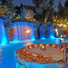 Love the water features & lighting in this pool