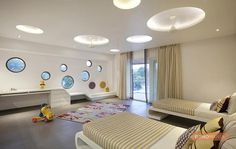 Circular peep-hole windows satisfy the perennial curiosity of kids while also giving a feeling of being in a submarine in this room. Indian Home Design, Indian Home Interior, Home Interior Design, Architects In Pune, Cool Beds, Awesome Beds, Bedroom Ceiling, Ceiling Design, Kids Bedroom