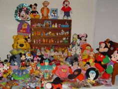 FOR SALE: MICKEY & MINNIE MOUSE Collection. Over 250 Pieces. Asking $500.00 / Or Best Offer. Includes WINNIE THE POOH & GANG Collection. There are Pins, Postcards, Lawn Ornaments, Solar Ornaments, Vintage Items (70's Candy Dish, 70's Donald Duck Bank and more). Kids Slippers (3), Toys, Salt and Pepper Shakers, Mickey Cookie Jar, Mickey (Wizard) Bank, Minnie Blanket, Snow Globes (Mini), Pez, Books. Princess Figurines, Tigger, Pooh, Seven Drawfs, and so much more