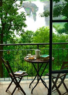 Rainforest Resort, Athirapally: How would it feel like to stay in the midst of a virgin #rainforest and draw your curtains to a breath-taking 180-degree view of the #waterfall view right from your living room? Chic interiors with a touch of minimalism is the hallmark of this place at #Athirapally. (image: rainforest resort)