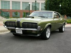 My first car and a beauty. 1970 Mercury Cougar featuring a 351 Cleveland engine probably only firing on 6 cylinders and in desperate need of a break job!!!!                                                                                                                                                                                 More