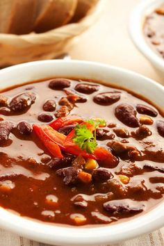 Recipe including course(s): Entrée; and ingredients: beans, black beans, corn, diced green chiles, lean ground beef, onion, salad dressing mix, taco seasoning mix, tomato sauce, water
