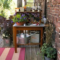 Easy Outdoor Room Idea Do Double Duty:   Ensure your outdoor room is party-ready with features that do double duty. This potting bench doubles as a sideboard with space to chill and pour drinks.