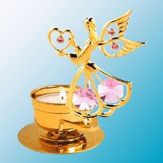 Angel Holds A Heart - Tealight Candle Holder - Swarovski Elements - 6 Color Choices  -- Are angels always with us? This one is, and she's a beauty. Our little angel, with open wings and a gentle heart in hand, guards a 24k gold plated tealight candle holder adorned with Swarovski crystals. Sum it up: gleaming gold plating, crystals capturing surrounding light and candle light. Be in the moment.