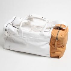 Maison Martin Margiela Cream & Tan Holdall  Check out more fashion pics at http://brvndon.com