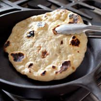 We set out to reproduce the charred exterior and tender interior of naan baked in a tandoor—but without the 1,000-degree heat.
