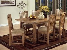 This large solid oak dining room table can seat six family members comfortably. Two extensions attach on either side of the table, to seat up to 8 people, and feature pull out supports for added stability. Rustic Dining Table Set, Oak Dining Room, Kitchen Dining Sets, 7 Piece Dining Set, Dining Room Sets, Dining Room Design, Dining Furniture, Cabin Furniture, Kitchen Ideas