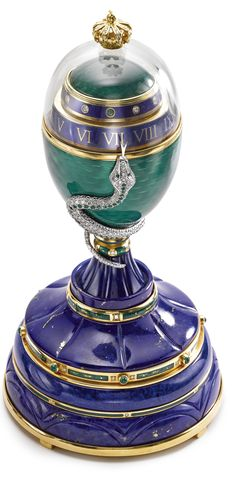 FABERGÉ AN 18K GOLD, LAPIS LAZULI, ROCK CRYSTAL AND ENAMEL EGG-FORM ANNULAR EIGHT-DAY DESK TIMEPIECE WITH DIAMOND- AND EMERALD-SET SERPENT 1997 NO 5/10