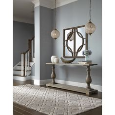 Take a step back in time with this antique balustrade design inspired console table. This versatile piece is hand-constructed of reclaimed pine with a vintage white wash finish or sleek black for the perfect addition to any room.