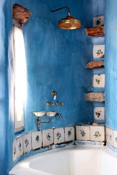 Euro-bathroom. Love the blue wash on the plaster.
