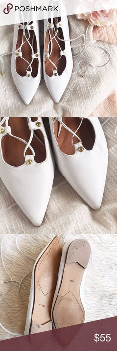 White pointy toe lace up flats Halogen | 'Owen' ghillie flat in a soft white leather. These versatile lace-up flats feature a pointy toe and gold tone details. Pair these pretty flats with distressed jeans for a perfectly on-trend look! Bottoms are lightly worn as shown in 3rd photo; in excellent used condition.   Size: 7 1/2  [Last photo taken from Nordstrom.com; all other photos are my own and may not be used.] Halogen Shoes Flats & Loafers