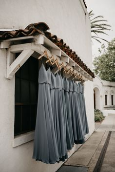 Soft grey bridesmaids dresses set on custom monogrammed hangers ready for this California Wedding. Photo by Feather + North and Erin Northcutt. Wedding Planning by Bella Baxter Events