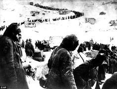 German prisoners of war captured by the Russians march in a long line winding over a hill toward a prison camp near Stalingrad in January 1943. Of the 110,000 German soldiers who surrendered at Stalingrad, 1/2 would die within a month and only 5000 would make it home, in 1955. They were forced to walk 2000 miles to freedom.
