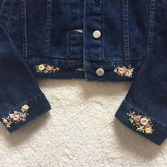 Dark denim jacket with ruffle along the back and down the back of the arms. Embellished with quirky florals in pastel tones. Floral accents on the collar, cuffs, chest pockets and the waist edge of the jacket. Embroidery On Clothes, Cute Embroidery, Embroidered Clothes, Hand Embroidery Patterns Flowers, Hand Embroidery Designs, Costura Diy, Do It Yourself Fashion, Denim Crafts, Diy Clothes