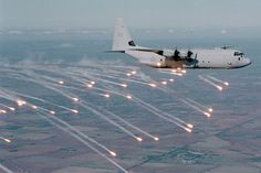 Royal Australian Air Force C-130J-30 launches flares.