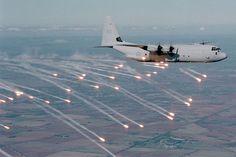 Royal Australian Air Force C-130J-30 launches flares.