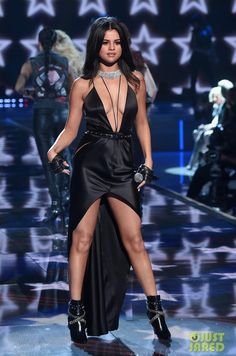 Selena Gomez wearing Saint Laurent Fetish Chain-Wrapped Tumbled Leather Boot, Saint Laurent Classique Studded Belt, Messika Collar Necklace and Louis Vuitton Spring 2016 Leather Fingerless Gloves