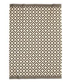 Check this out! Een groot vloerkleed van katoen met een geprint dessin. – Ga naar hm.com om meer te bekijken.