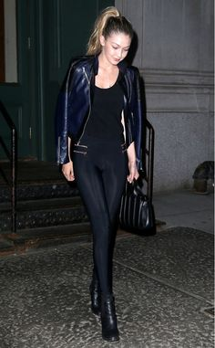 Gigi Hadid dresses up her zipper moto leggings with black heeled ankle boots and a sleek leather jacket for a night out.