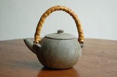 Old Korean teapot made of carved stone, with bamboo handle of the late Shochikudo Kosuge