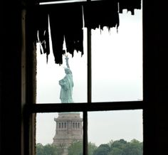 Neat view of The Statue of Liberty, seen thru the contagious disease ward on Ellis Island. #saveellisisland #ellisisland