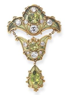 A FINE ART NOUVEAU PERIDOT, DIAMOND AND ENAMEL BROOCH, BY MARCUS & CO., CIRCA 1900. Designed as a green plique-à-jour enamel plaque, centring upon an oval-cut peridot, enhanced by old European-cut diamond collet and textured gold trim, suspending a smaller plaque of similar design, to the drop-shaped pendant, set with a pear-shaped peridot and textured gold scroll motifs, mounted in gold, signed Marcus & Co. #Marcus #ArtNouveau #brooch