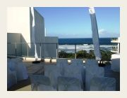 Mudjimba beach is popular for weddings. Nearly Surfair at Marcoola has the ocean view and is under cover. This penthouse was a stairway from the accommodation and the kitchen. kayfranks.com.au  Kay Franks Celebrant