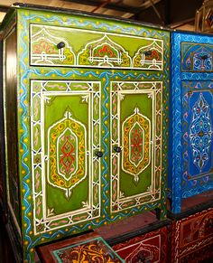 Moroccan painted furniture...looks complex and painstaking but the key is to find furniture with carved areas in this pattern, or those that with the right color scheme (especially the one on the right) would look instantly Moroccan. too freaking cool.