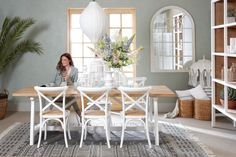 CROSS CHAIR, LAVAL MIRROR, BRUGGE DINING TABLE WHITE LEGS