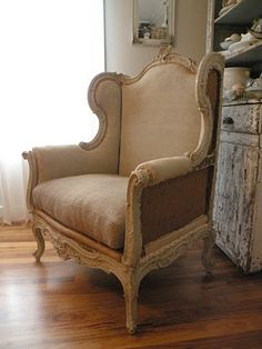 Beautiful carved French Wingback Chair in a soft linen.
