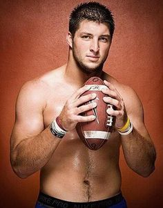 Don't normally post pics of half naked men...but he is holding a football.