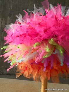 We stacked a bunch of tutus together for carrying around during a photo shoot. But if you did this in your wedding colors it could be awesome as a table centerpiece for a party!