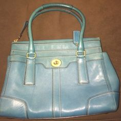 Teal coach bag Teal leather coach bag. In great condition, one stain on bottom of bag & one gum stain inside bag. Gold hardware with zipper closure. Perfect bag for a pop of color Coach Bags Totes
