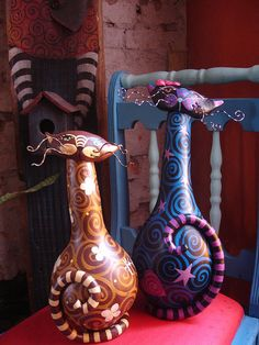 I think these are made from gourds, polymer clay and paint. Right up my alley!