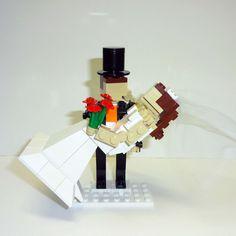 Custom LEGO Groom holding Bride Wedding Cake Topper by FoldedFancy