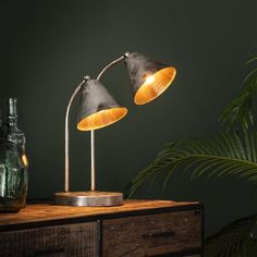 This industrial table lamp has two light sources and is made of metal and is finished in old silver. The light sources distributes the light in a beautiful way through the room, creating a great ambiance. Desk Lamp, Table Lamp, Drop Lights, Lumiere Led, Industrial Table, Led Lampe, Beautiful Lights, Ceiling Lights, Lighting