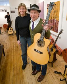 Paul Simon with one of the Metheny-Manzer Signature 6 guitars by Linda Manzer.