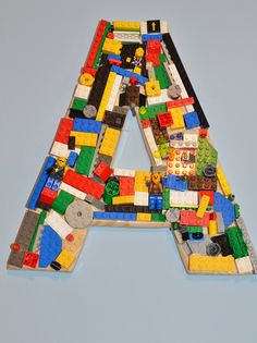 Lego Room Idea!  Hot glue lego to a wooden letter. Layer on to create some demension.
