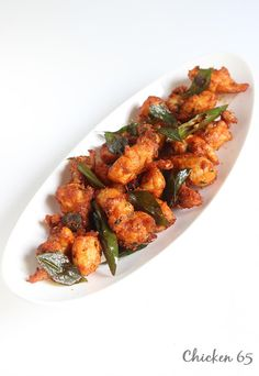 chicken 65 recipe, a popular south Indian street food. Flavorful, delicious and crispy chicken 65 with curry leaves and chilies. Recipe with step by photos.