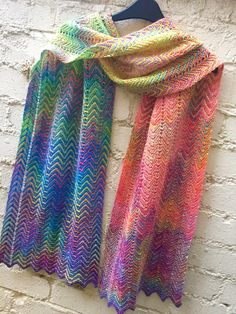 A combination of a varigated sock yarn and rainbow mini skeins to work a subtle…