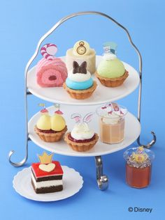 Enjoy an Alice In Wonderland afternoon high tea party with Cozy Corner bite-size character cakes Lemon Cream Cake, Pistachio Cream, Disneyland Food, Disney Food, Disney Recipes, Disney Dinner, Jam Tarts, Afternoon Tea Parties, Character Cakes