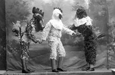 Chicken little, chicken big: A trio dressed in Mardi Gras costumes in this snapshot from 1911 (Den Bosch, The Netherlands)