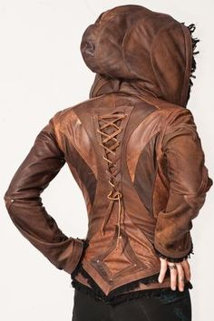 Victory leather jacket womens cut : - Info - Size Chart The Victory jacket's graceful design features V-shaped detailing across the back, hood and down the sleeves. Leather lacing down the spine and the frayed fringe lining the geometri Vintage Jacket, Leather And Lace, Men's Leather, Distressed Leather, Vintage Leather, Leather Totes, Leather Purses, Sewing Clothes, Men Clothes