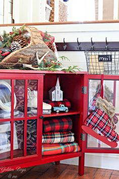 Christmas Entryway with red Target bookcase, plaid and evergreen basket from Joss and Main - www.goldeboysandme.com