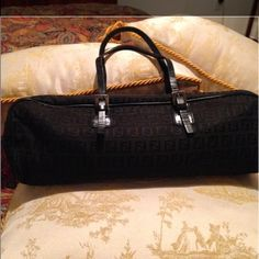 """NEED TO Go! Authentic Fendi Barrel Zucca Classic Fendi Black Barrel. Its a perfect size for everyday purse. The purse is made of zucca canvas with black leather trim and a gun metal hardware. All metal hardware got fendi. Its got its serial posted. In good condition no wear on edges no rips no stain. Minor sign of wear on strap sign of use. Nothing no tear rip or separation. A great buy.!! Size 12""""x4""""5 ill post pic carrying it. No dustbag.Lining got fendi printed. Plz no low balling if u…"""