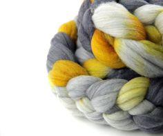 """Ages of Man is a colorway I created for the November 2015 """"Mythology"""" Phat Fiber box. According to Hesiod in """"Works and Days"""", there are 5 Ages of Man, which I represented with both the fiber choice and they dye colors. The fiber blend is super soft merino wool with just a touch of bronze sparkles.   #AgesofMan #MMMakers #KittyMineCrafts #Wool #Woolroving #SpinningFiber #Handspinners #Indiedyer"""