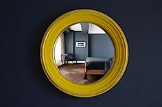 Round wall mirror in yellow finish available with convex or flat mirror. Omelo Mirrors's Lucca design handpainted in yellow with hand-leafed brass beading - Omelo Decorative Convex Mirrors