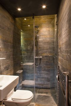 Shower Room in North London by Xul Architecture. Dark.